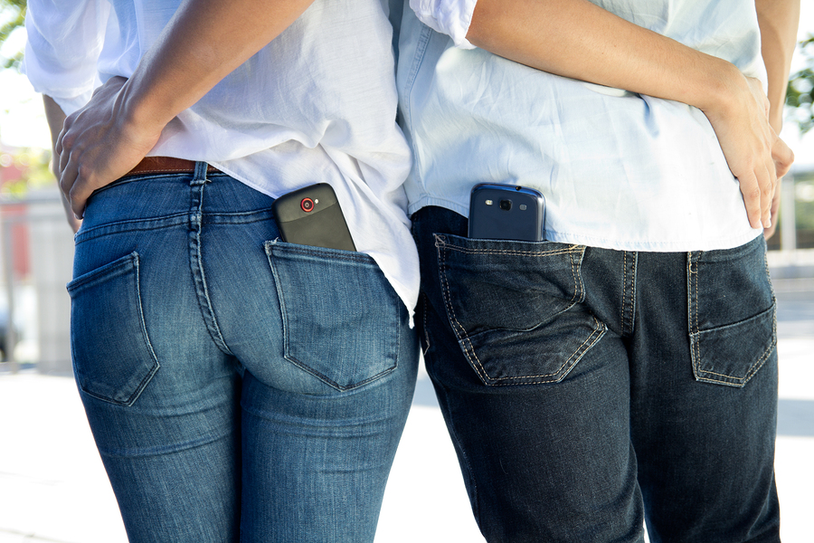 Young couple with mobile in the pocket